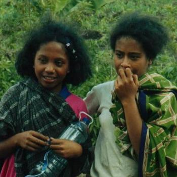 Bought sugar cane from these girls, Flores, Indonesia