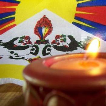 Tibetan flag and candle: dino/Sth Gippsland