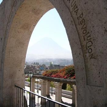 Volcan Misti just visible through the archway, Arequipa, Peru