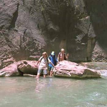 Crossing the stream in the Zion narrows
