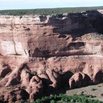 Canyon de Chelly in Arizona; see dwellings in horizontal crack of cliff?