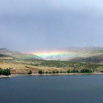 Rainbow in Distant Valley Across Utah Reservoir