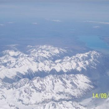 Flying in to NZ over snow covered mountains
