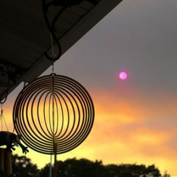Red sun from wildfire smoke in Utah