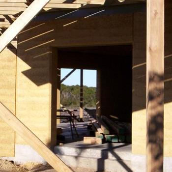 Rammed earth and timber. My son's house under construction/ dino