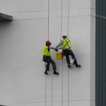 SLJ08 flies on the wall window cleaners at work (female & male) taken from the top of the multistorey car park at RNSH St Leonards Kate/Sydney