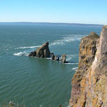 The tide coming in around Cape Split at the entrance to Minas Basin, NS, Canada.