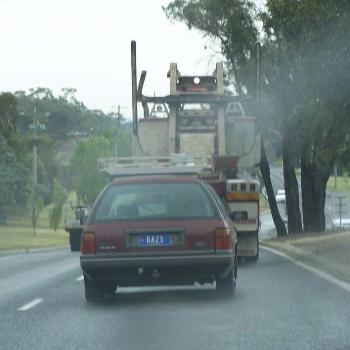 What was Baz doing tailing a log truck in Traralgon mid January?