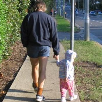 Laura and Daddy walking home from the park