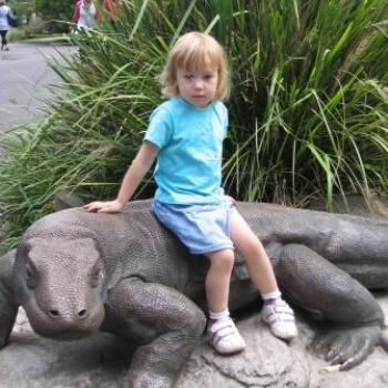 Laura on a komodo dragon