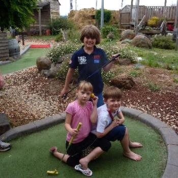 A game of Put Put Golf for Kyle, Rhys and Laura. (June)