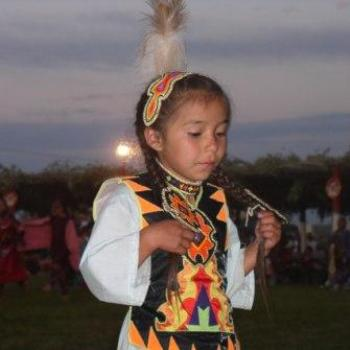 My favorite tired little girl at the Ute/Ouray Pow-Wow in Utah, July 2008, by Wilodene