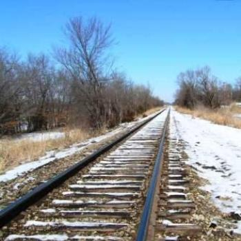 Snow starting to melt along the railroad tracks  Sue/OK